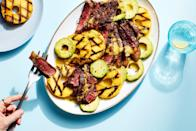 """A fresh, bright pineapple dressing ties together this irresistible platter of grilled pineapple rings, strip steak, and avocado. Finish it all off with a drizzle of pineapple dressing across the entire platter. <a href=""""https://www.epicurious.com/recipes/food/views/3-ingredient-grilled-steak-pineapple-and-avocado-salad?mbid=synd_yahoo_rss"""" rel=""""nofollow noopener"""" target=""""_blank"""" data-ylk=""""slk:See recipe."""" class=""""link rapid-noclick-resp"""">See recipe.</a>"""