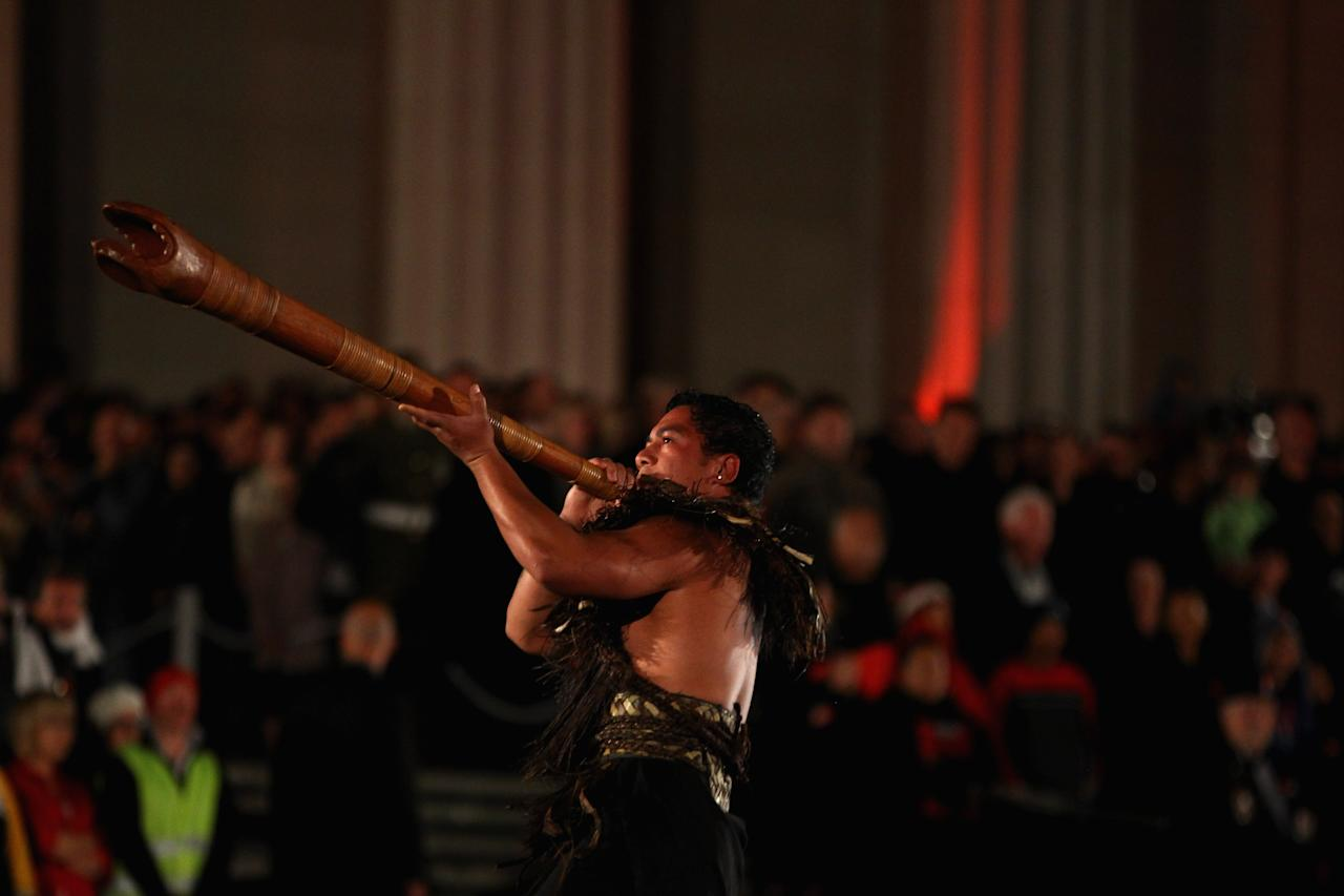 A Maori warrior signals the arrival of veterans, dignitaries and members of the public to the Cenotaph at the Auckland War Memorial Museum during the ANZAC Day Dawn Service on April 25, 2012 in Auckland, New Zealand. Veterans, dignitaries and members of the public today marked ANZAC (Australia New Zealand Army Corps) Day, when First World War troops landed on the Gallipoli Peninsula, Turkey early April 25, 1915, commemorating the event with ceremonies of remembrance for those who fought and died in all wars.  (Photo by Phil Walter/Getty Images)