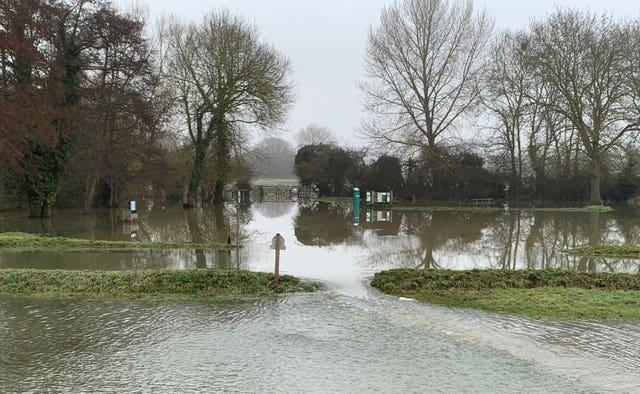 Flooding closes the road past Cookham Moor after the Thames burst its banks near the Berkshire village