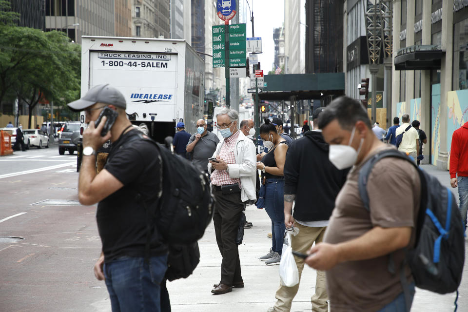 Workers are seen waiting for the bus. This week New York City marks the first phase of the economic reopening as construction, consumer goods and services, resume limited operation, on June 11, 2020 in New York City, US. (Photo by John Lamparski/NurPhoto via Getty Images)