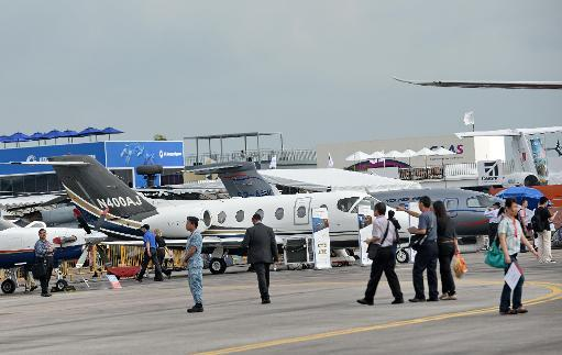 <p>Commercial places on display at the Singapore Airshow on February 13, 2014</p>
