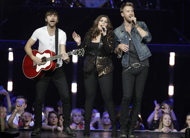 """FILE - This May 16, 2012 file photo shows, from left, Lady Antebellum's Charles Kelly,  Dave Haywood and Hillary Scott performing in Louisville, Ky. The platinum-selling trio plan to release a Christmas album, """"On This Winter's Night"""" on Oct. 22. (AP Photo/Darron Cummings, file)"""