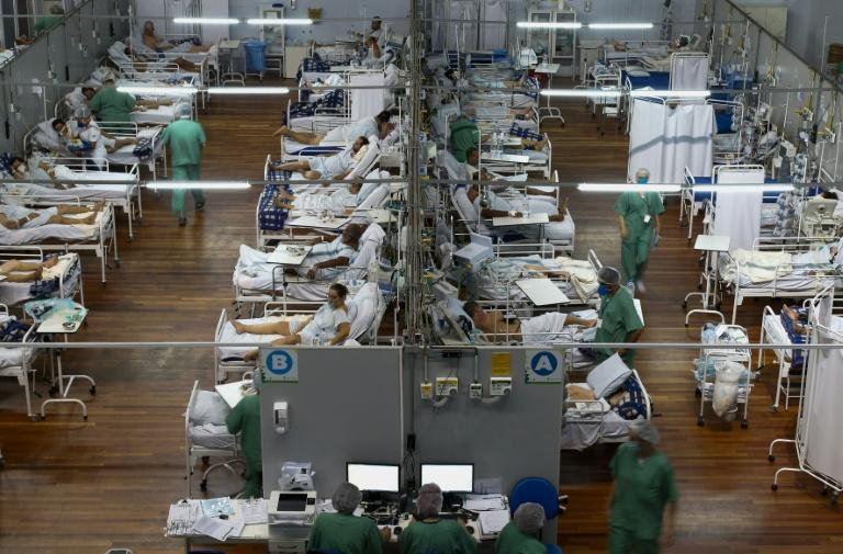 Covid-19 patients in Brazil are treated in a field hospital set up in a gym in the town of Santo Andre on March 26, 2021