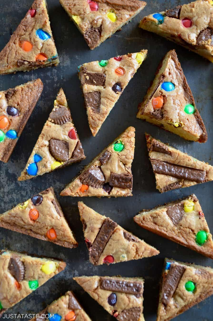 """<p>These blondies look utterly delicious! They're such a fun, simple way to put your Halloween candy to good use.</p><p><strong>Get the recipe at <a href=""""https://www.justataste.com/leftover-halloween-candy-blondies-recipe/"""" rel=""""nofollow noopener"""" target=""""_blank"""" data-ylk=""""slk:Just a Taste"""" class=""""link rapid-noclick-resp"""">Just a Taste</a>.</strong></p><p><strong><a class=""""link rapid-noclick-resp"""" href=""""https://go.redirectingat.com?id=74968X1596630&url=https%3A%2F%2Fwww.walmart.com%2Fbrowse%2Fhome%2Fbakeware%2Fthe-pioneer-woman%2F4044_623679_8455465&sref=https%3A%2F%2Fwww.thepioneerwoman.com%2Ffood-cooking%2Fmeals-menus%2Fg32110899%2Fbest-halloween-desserts%2F"""" rel=""""nofollow noopener"""" target=""""_blank"""" data-ylk=""""slk:SHOP BAKEWARE"""">SHOP BAKEWARE</a><br></strong></p>"""