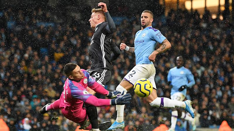 Pictured here, Manchester City goalkeeper Ederson is given a red card for a first half foul.