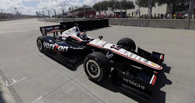Will Power, of Australia goes through a temporary chicane in turn one during practice for the IndyCar Grand Prix of Houston auto race, Friday, Oct. 4, 2013, in Houston. Practice was delayed due to surface issues in turn one. (AP Photo/David J. Phillip)