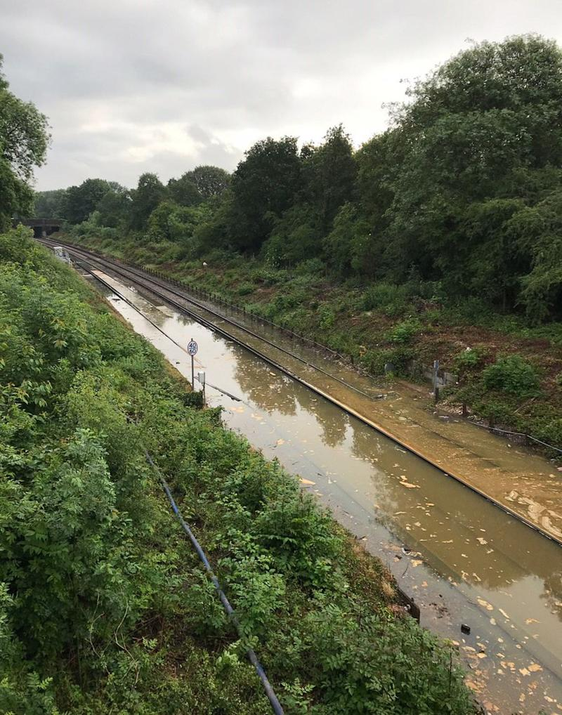 Network Rail posted an image of flooding at Mitcham Junction (Picture: PA)