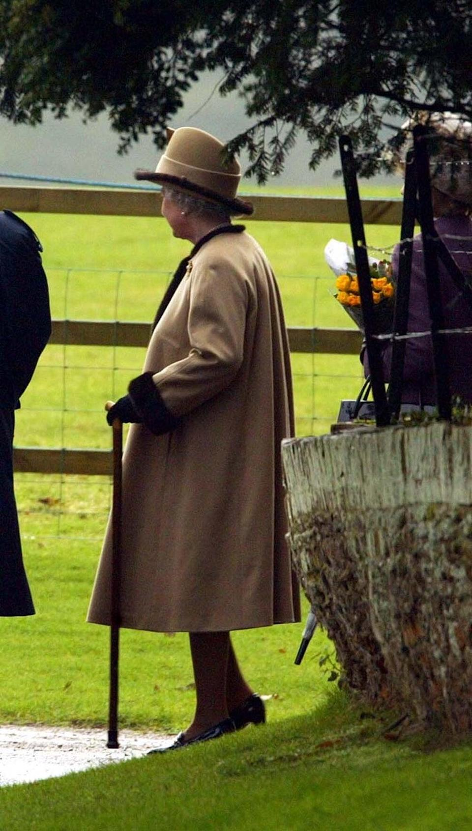 The Queen using a stick at church service in 2003 (Andrew Parsons/PA) (PA Archive)