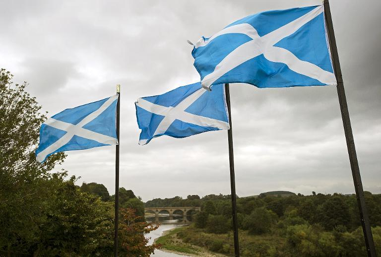 Saltire flags next to the River Tweed in Coldstream, a town on the border between England and Scotland (AFP Photo/Lesley Martin)