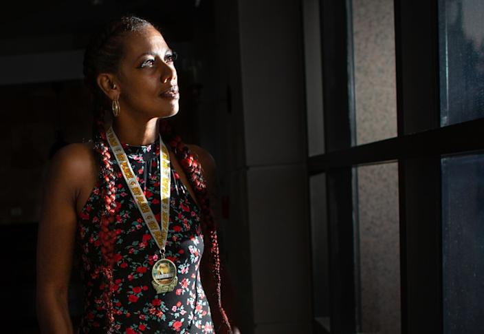 """Taloma Miller wears one of Semaj's basketball medals. <span class=""""copyright"""">(Jason Armond / Los Angeles Times)</span>"""