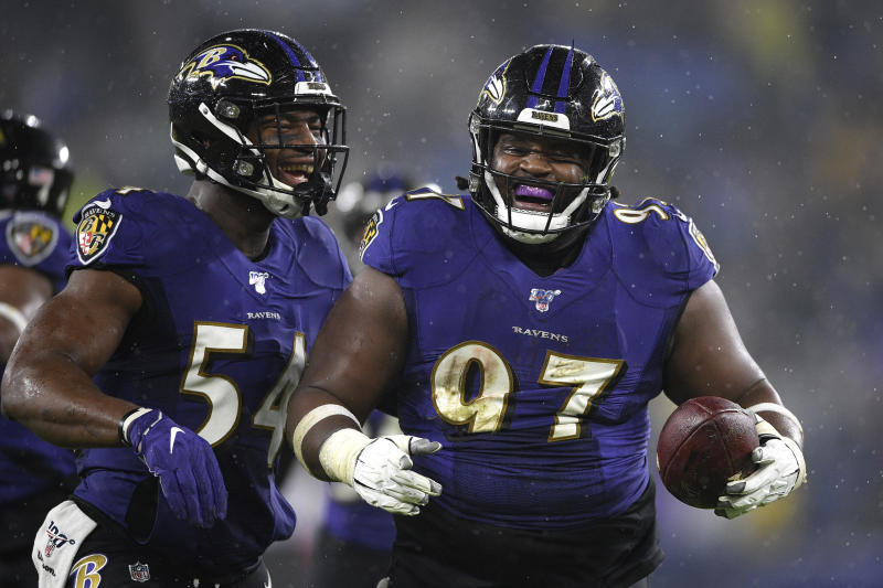 Baltimore Ravens defensive tackle Michael Pierce (97) celebrates his fumble recovery with linebacker Tyus Bowser (54) during the first half of an NFL football game against the Pittsburgh Steelers, Sunday, Dec. 29, 2019, in Baltimore. Steelers quarterback Devlin Hodges fumbled the ball on a strip sack by Ravens outside linebacker Matt Judon. (AP Photo/Nick Wass)