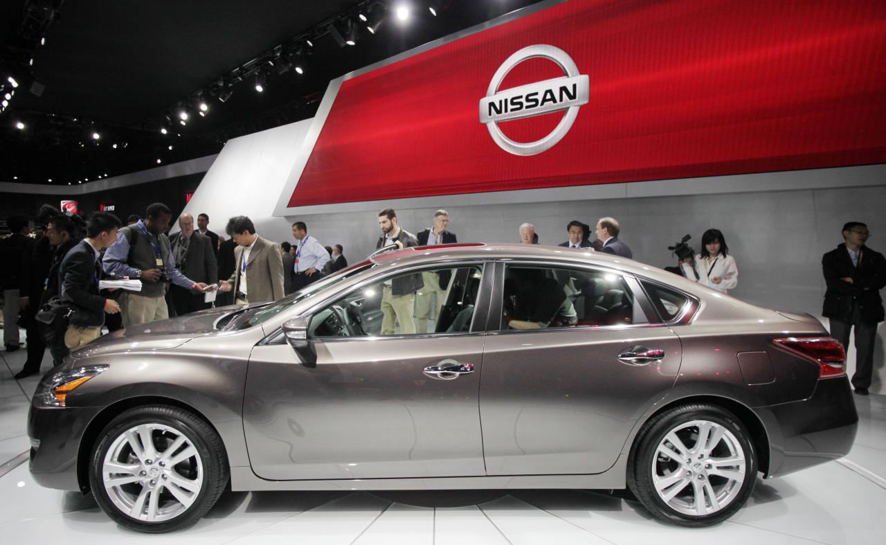 A crowd gathers around a 2013 Nissan Altima 3.5 SL sedan, Wednesday, April 4, 2012 at the New York International Auto Show. (AP Photo/Mark Lennihan)