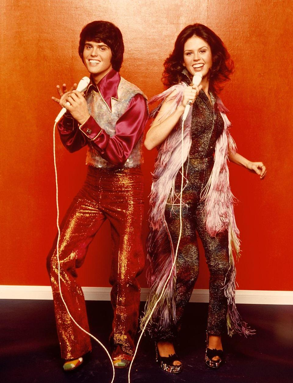 <p>Lamé? Check. Silky polyester shirt? Check. Fringe? Check. Platforms? Check. Looks like Donny and Marie Osmond are all set to boogie. </p>