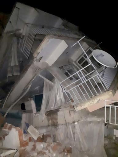 A collapsed building is seen following a 6.8 magnitude earthquake in Elazig, eastern Turkey on January 24, 2020, killing several people; The quake shook the Sivrice district in the eastern province of Elazig at around 8.55 pm (1755 GMT)