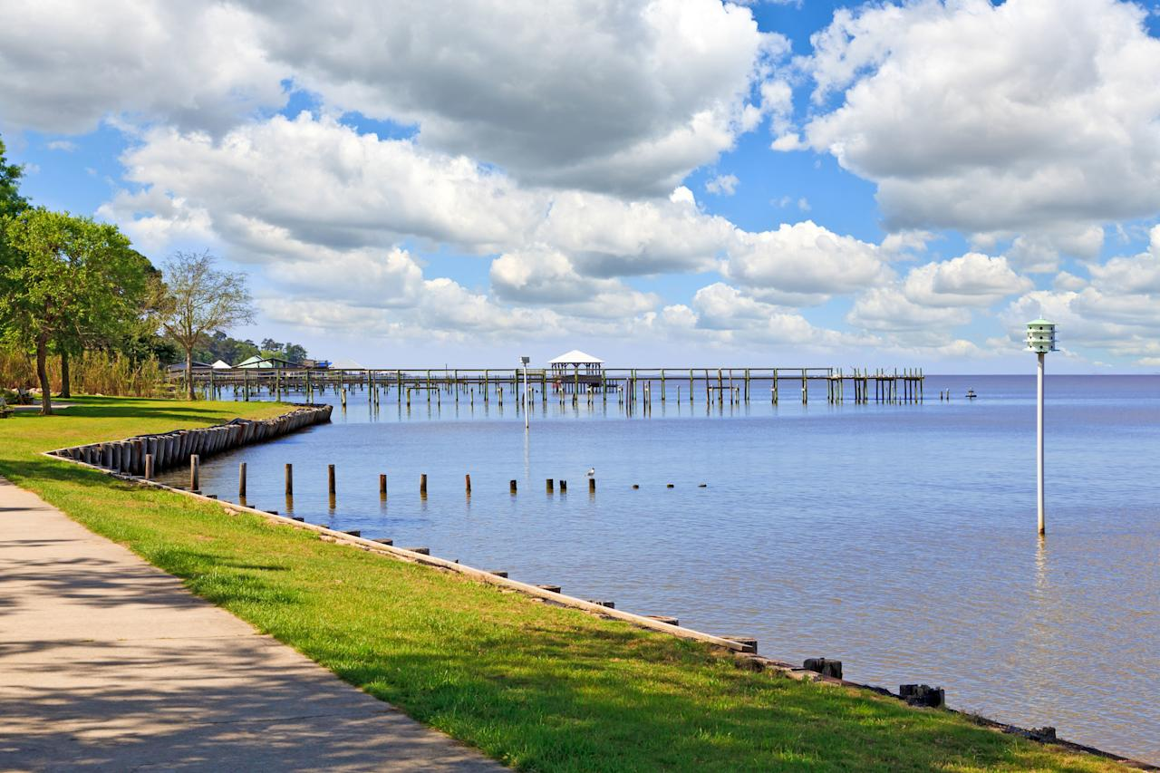 """<p>This gem on Mobile Bay along the shimmering Gulf of Mexico has a sweet little downtown complete with waterfront park, <a href=""""https://www.coastalliving.com/travel/gulf-coast/best-beaches-alabama?slide=276611#276611"""" target=""""_blank"""">a pair of lovely beaches</a>, and fishing pier. An added (and somewhat secret) charm: Point Clear just to the south, with a stunning bayside walking path that begins from the equally picturesque and gracious <a href=""""https://www.grand1847.com/"""" target=""""_blank"""">Grand Hotel Golf Resort and Spa.</a></p>"""