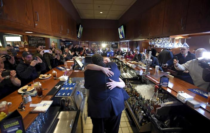 <p>Republican presidential candidate New Jersey Gov. Chris Christie hugs bartender Angela Normyle as he makes a stop to greet voters at T-Bones Great American Eatery in Derry, N.H., on Feb. 9, 2016. <i>(Photo: Gretchen Ertl/Reuters)</i></p>