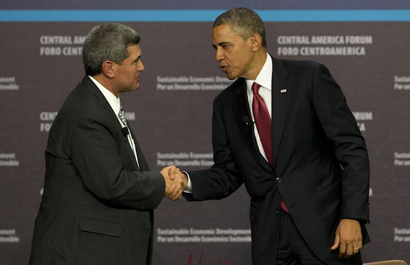 President Barack Obama, right, shakes hands with INCAE University President Arturo Condo at the end of an Inclusive Economic Growth and Development forum in San Jose, Costa Rica, Saturday, May 4, 2013. (AP Photo/Moises Castillo)