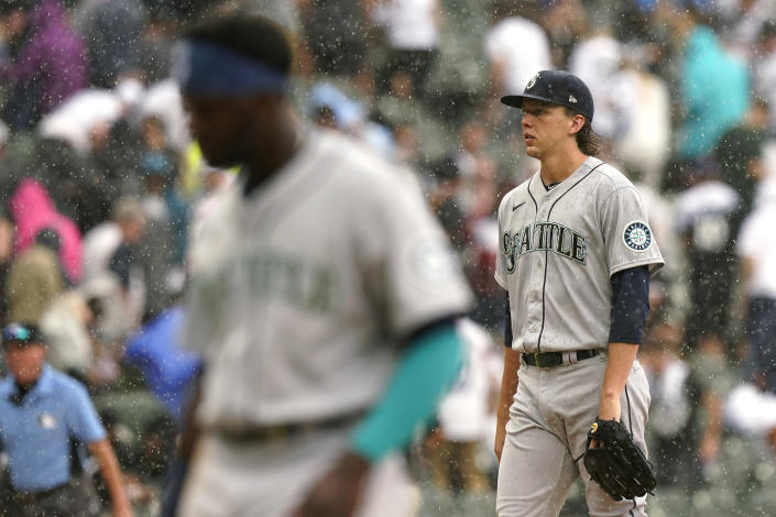 Seattle Mariners starting pitcher Logan Gilbert walks to the dugout during a rain delay in the third inning of a baseball game against the Chicago White Sox in Chicago, Saturday, June 26, 2021. (AP Photo/Nam Y. Huh)