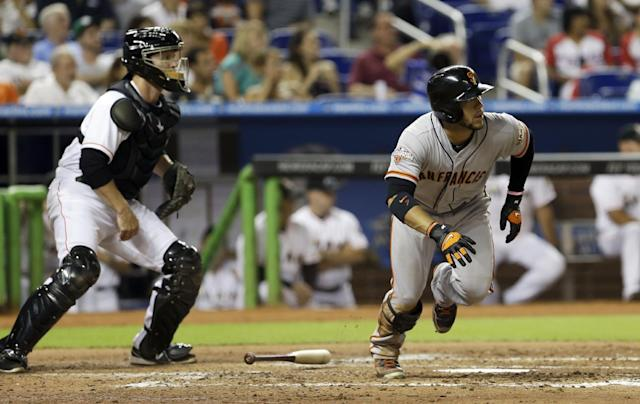 San Francisco Giants' Gregor Blanco prepares to run the bases after hitting a triple against the Miami Marlins in the fourth inning of a baseball game, Saturday, Aug. 17, 2013, in Miami. Roger Kieschnick and Pablo Sandoval scored on the triple. (AP Photo/Alan Diaz)