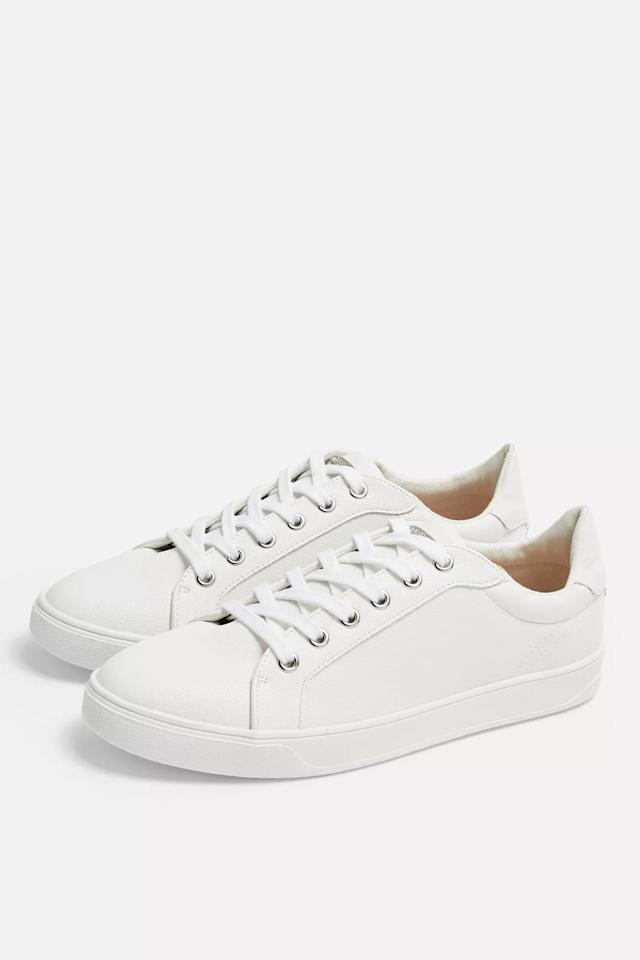 """<p>You can't go wrong with these <a href=""""https://www.popsugar.com/buy/Topshop%20Cola%20Trainers-469906?p_name=Topshop%20Cola%20Trainers&retailer=us.topshop.com&price=40&evar1=fab%3Aus&evar9=45128435&evar98=https%3A%2F%2Fwww.popsugar.com%2Ffashion%2Fphoto-gallery%2F45128435%2Fimage%2F46397175%2FTopshop-Cola-Trainers&list1=shopping%2Cfall%20fashion%2Cshoes%2Cfall%2Cbest%20of%2Cbest%20of%202018&prop13=mobile&pdata=1"""" rel=""""nofollow"""" data-shoppable-link=""""1"""" target=""""_blank"""" class=""""ga-track"""" data-ga-category=""""Related"""" data-ga-label=""""https://us.topshop.com/en/tsus/product/wide-fit-cola-trainers-8943091"""" data-ga-action=""""In-Line Links"""">Topshop Cola Trainers</a> ($40).</p>"""