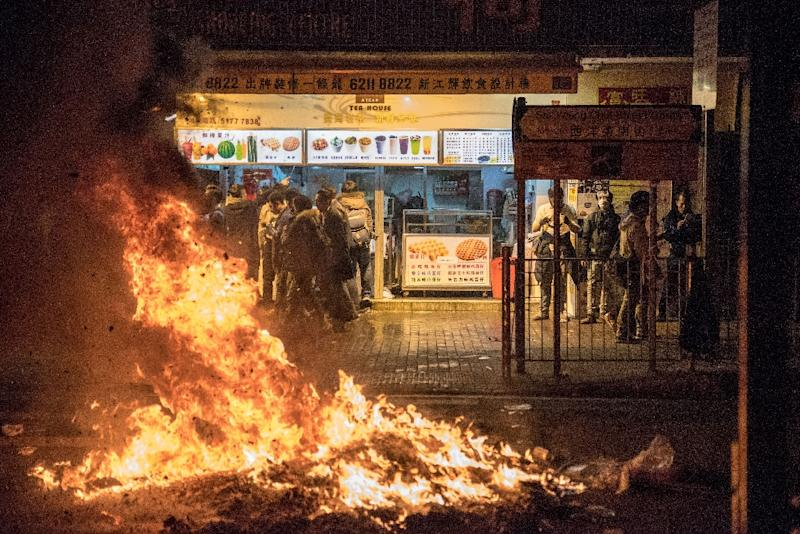 Ray Wong and Alan Li are wanted for riot charges relating to Lunar New Year clashes in February 2016, when protesters hurled bricks torn up from pavements and set rubbish alight in the commercial district of Mong Kok (AFP Photo/Terry WONG)
