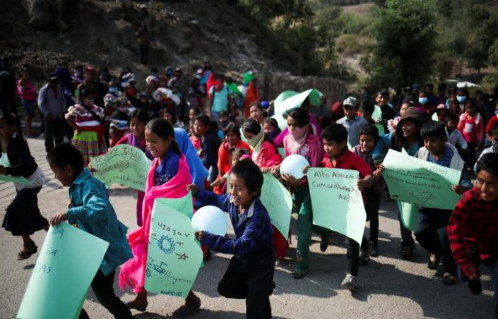 Children take part in a demonstration in Alcozacan