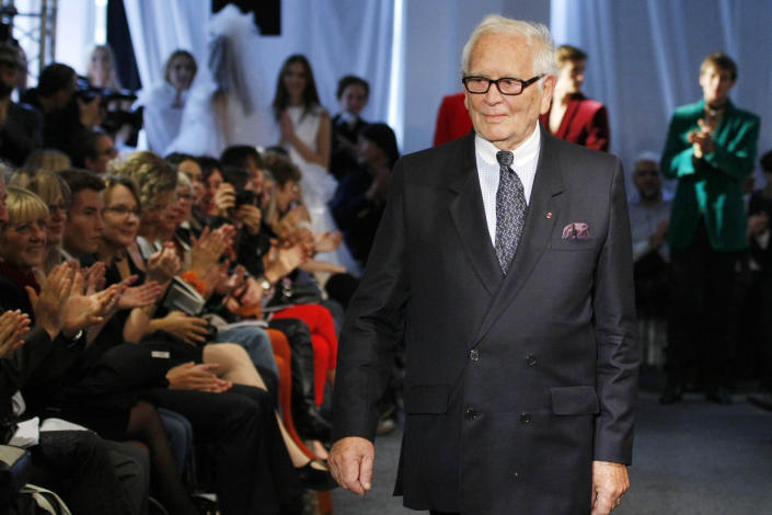 FILE - In this Sept.29, 2010 file photo, French fashion designer Pierre Cardin acknowledges applause after his ready to wear spring/summer 2011 collection presented in Paris. France's Academy of Fine Arts says Pierre Cardin, the French designer whose Space Age style was among the iconic looks of 20th-century fashion, has died at 98.(AP Photo/Jacques Brinon, File)