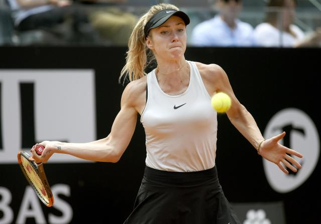 Ukraine's Elina Svitolina returns the ball Estonia's Anett Kontaveit during their women's singles semifinal, at the Italian Open tennis tournament in Rome on Saturday, May 19, 2018. (Claudio Onorati/ANSA via AP)