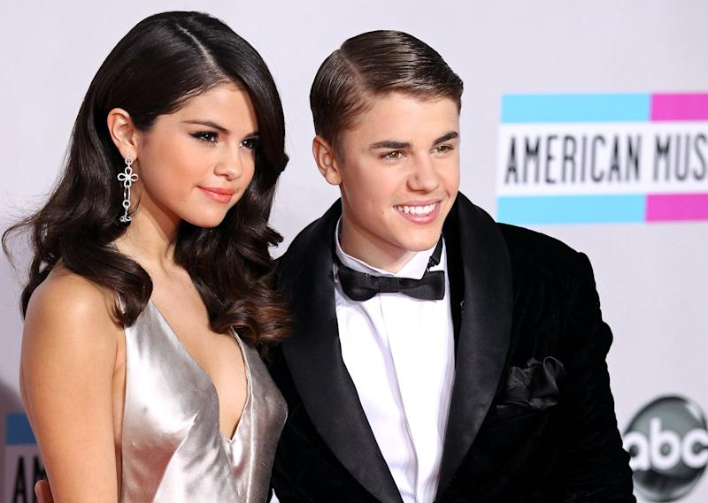 LOS ANGELES, CA - NOVEMBER 20: Selena Gomez and Justin Bieber arrive at the 2011 American Music Awards held at Nokia Theatre L.A. LIVE on November 20, 2011 in Los Angeles, California. (Photo by JB Lacroix/WireImage)