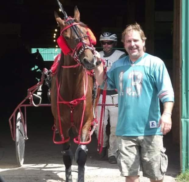 Jamie Hogan with Broadway Bill during his racing days. (Kelly Nicholson - image credit)
