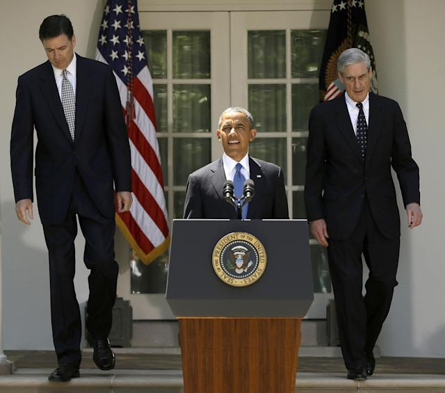 <p>President Barack Obama, followed by outgoing FBI Director Robert Mueller, right, and his choice to succeed Mueller, James Comey, left, walks towards the podium in the Rose Garden of the White House in Washington on June 21, 2013. The Justice Department on May 17, 2017, appointed Mueller as a special counsel to oversee a federal investigation into potential coordination between Russia and the Trump campaign during the 2016 presidential election. (Photo: Pablo Martinez Monsivais/AP) </p>