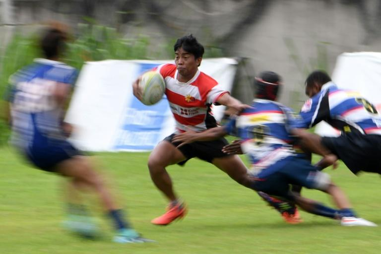 Lito Ramirez 2nd L outpaces a line of defenders during a match in Silangan Laguna south of Manila