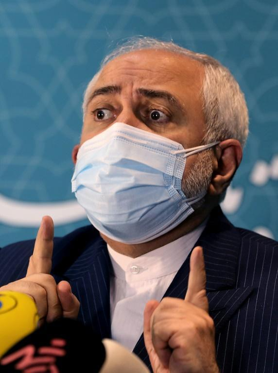 Iranian Foreign Minister Mohammad Javad Zarif, seen speaking in February 2021, has demanded the full lifting of US sanctions before Tehran returns to full compliance with a nuclear deal