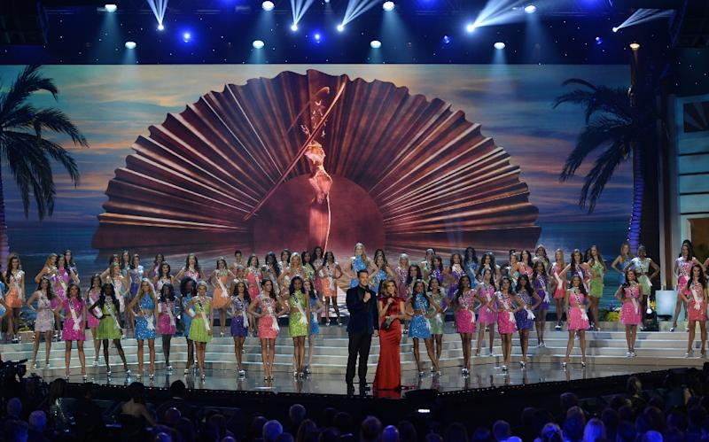 Contenstants pose on stage during the 63rd Annual Miss Universe pageant at Florida International University on January 25, 2015 in Miami