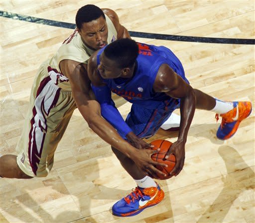 Florida State forward Terrance Shannon (2) goes for a steal against Florida forward Will Yeguete (15) in the first half of an NCAA college basketball game, Wednesday, Dec. 5, 2012, in Tallahassee, Fla. (AP Photo/Phil Sears)