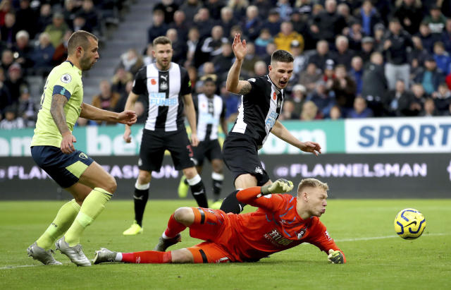 Newcastle United's Ciaran Clark scores his side's second goal of the game, during the English Premier League soccer match between Newcastle and Bournemouth, at St James' Park, in Newcastle, England, Saturday Nov. 9, 2019. (Owen Humphreys/PA via AP)