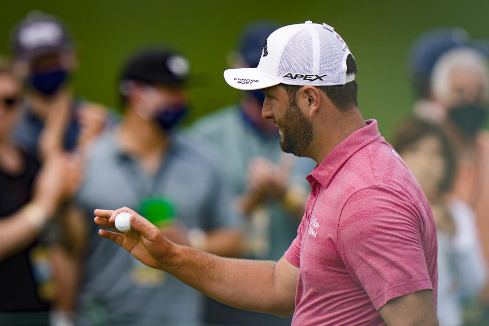 Jon Rahm, of Spain, holds up his ball after an eagle on the second hole during the final round of the Masters golf tournament on Sunday, April 11, 2021, in Augusta, Ga. (AP Photo/Matt Slocum)