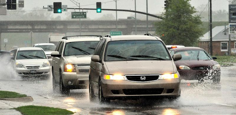 Traffic makes its way through heavy rain throughout the Jackson, Miss., area Sunday, April 6, 2014. On Sunday, street flooding plagued Jackson. Flood advisories for much of the state continued into Monday. (AP Photo/The Clarion-Ledger, Rick Guy ) NO SALES