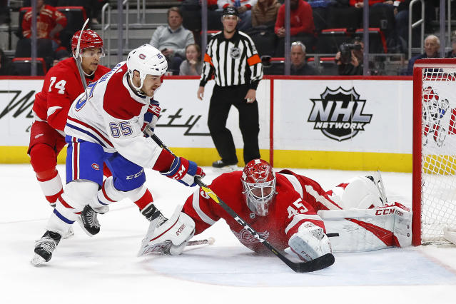 Montreal Canadiens right wing Andrew Shaw (65) scores on Detroit Red Wings goaltender Jonathan Bernier (45) in the third period of an NHL hockey game, Tuesday, Feb. 26, 2019, in Detroit. (AP Photo/Paul Sancya)