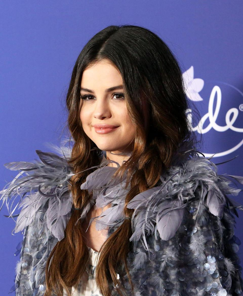 <p>Selena gave her lived-in beach waves a styled touch with easy loose braids. Take it from the best, it's a great way to get use out of day-three hair.</p>