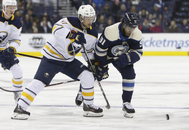 Buffalo Sabres' Vladimir Sobotka, left, of the Czech Republic, and Columbus Blue Jackets' Anthony Duclair chase the puck during the first period of an NHL hockey game Tuesday, Jan. 29, 2019, in Columbus, Ohio. (AP Photo/Jay LaPrete)