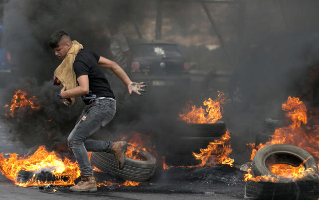 "<p>Palestinians protesters are seen during clashes with Israeli security forces after a protest marking Nakba, or ""catastrophe"", commemorating the more than 700,000 Palestinians who fled or were expelled in the 1948 war surrounding Israel's creation, and against the US' relocation of its embassy from Tel Aviv to Jerusalem, at the Hawara checkpoint south of Nablus on May 15, 2018. (Photo: Jaafar Ashtiyeh/ AFP/Getty Images) </p>"