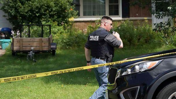 PHOTO: A Lake Hallie Police officer works outside a home, July 29, 2019, in Lake Hallie, Wis., following a shooting the night before. (Renee Jones Schneider/Star Tribune via AP)