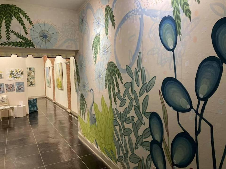 """A mural by Versailles artist Alex K. Mason at the entrance of the """"Informed by Nature"""" exhibit at the Headley-Whitney Museum."""