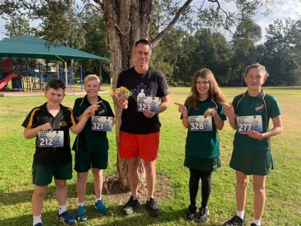 Matthew Reid, centre, was inspired by Terry Fox's story to raise money for children's charities in Australia. (submitted by Matthew Reid - image credit)