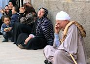 Relatives of supporters of Mohamed Morsi cry outside the courthouse on March 24, 2014 in the central Egyptian city of Minya, after the court ordered the execution of 529 Morsi supporters