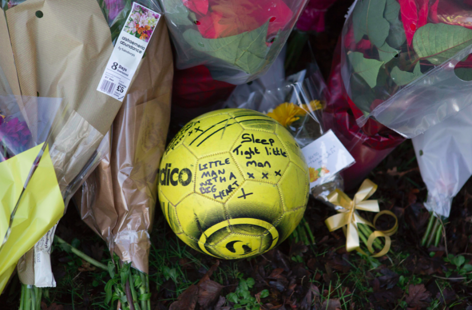 """A football inscribed with handwritten messages including """"sleep tight little man"""", and """"little man with a big heart"""" was left in tribute (PA)"""