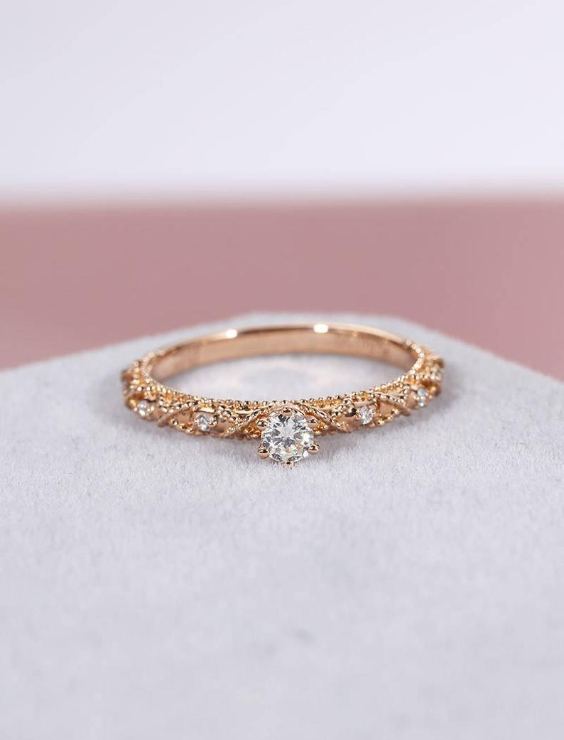 """<p>If they adore the look of vintage rings, they'll enjoy this <a href=""""https://www.popsugar.com/buy/Antique-Rose-Gold-Engagement-Ring-531229?p_name=Antique%20Rose%20Gold%20Engagement%20Ring&retailer=etsy.com&pid=531229&price=305&evar1=fab%3Aus&evar9=7954958&evar98=https%3A%2F%2Fwww.popsugar.com%2Fphoto-gallery%2F7954958%2Fimage%2F47020712%2FAntique-Rose-Gold-Engagement-Ring&list1=shopping%2Cwedding%2Cjewelry%2Crings%2Cbride%2Cengagement%20rings%2Cfashion%20shopping&prop13=api&pdata=1"""" rel=""""nofollow noopener"""" class=""""link rapid-noclick-resp"""" target=""""_blank"""" data-ylk=""""slk:Antique Rose Gold Engagement Ring"""">Antique Rose Gold Engagement Ring</a> ($305).</p>"""