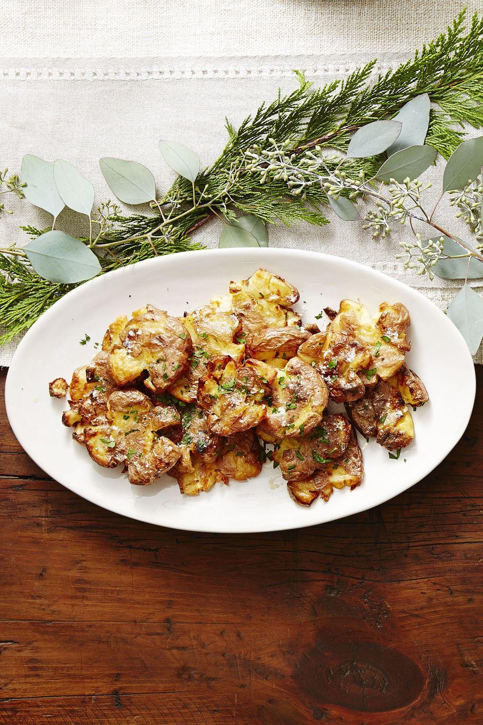 """<p>You'll forget all about the mashed potatoes once you taste these crispy, buttery spuds.</p><p><em><a href=""""https://www.goodhousekeeping.com/food-recipes/a41684/crispy-golden-smashed-potatoes-recipe/"""" rel=""""nofollow noopener"""" target=""""_blank"""" data-ylk=""""slk:Get the recipe for Crispy Golden Smashed Potatoes »"""" class=""""link rapid-noclick-resp"""">Get the recipe for Crispy Golden Smashed Potatoes »</a></em></p>"""