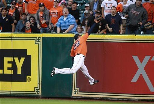 Houston Astros right fielder Rick Ankiel (28) leaps to make a catch for an out on Detroit Tigers Andy Dirks during the third inning of a baseball game Friday, May 3, 2013, in Houston. (AP Photo/Patric Schneider)